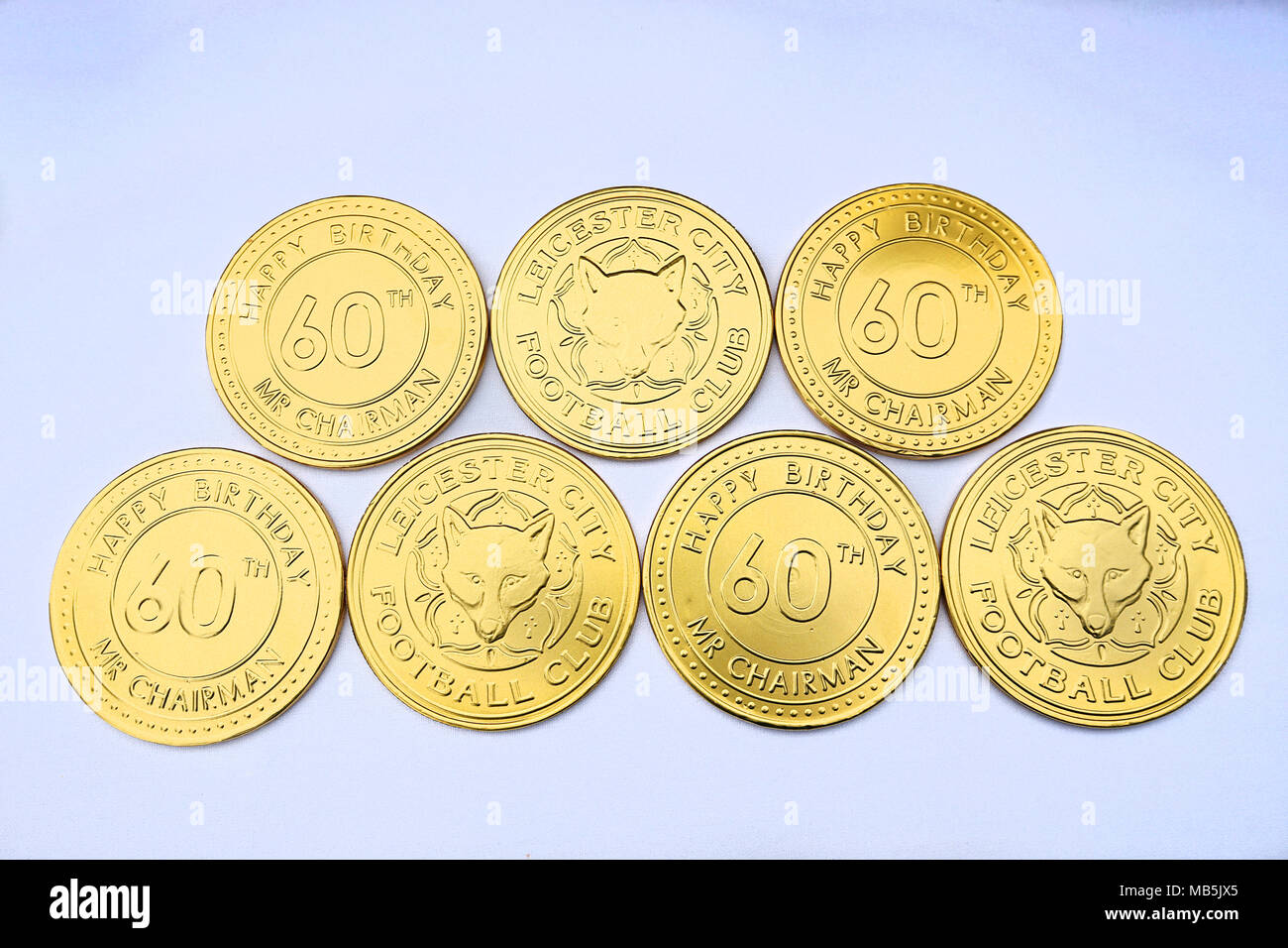 Chocolate coins being given away by Leicester City for the 60th anniversary of the chairman during the Premier League match at the King Power Stadium, Leicester. - Stock Image