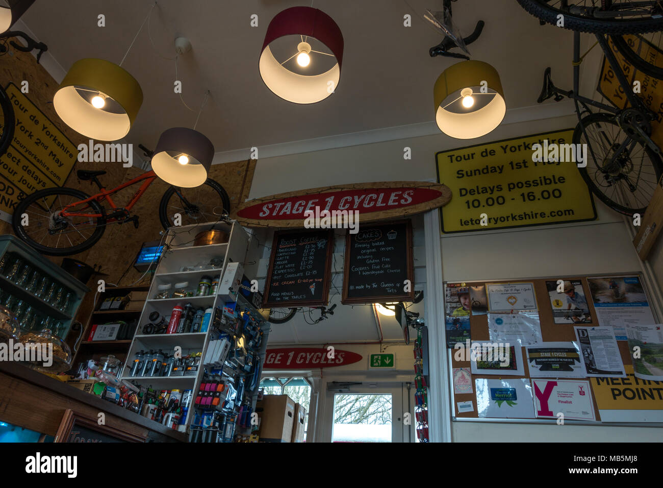 Inside the Stage 1 Cycles cafe, Firefox cafe in Hawes with Tour de Yorkshire memorabilia - Stock Image