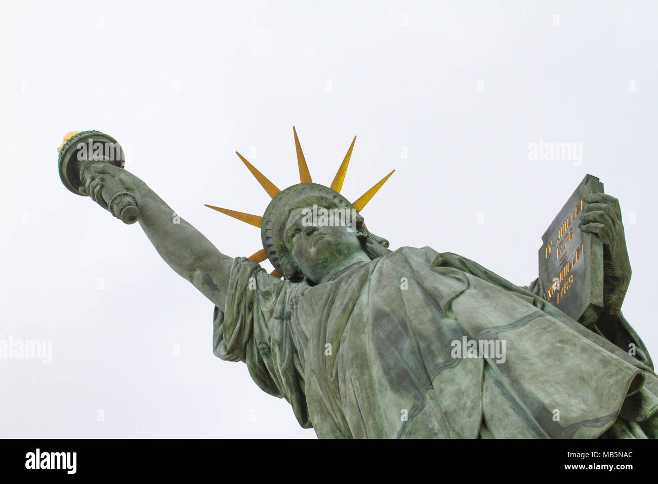 Paris, France -  04 April, 2018. A replica of the Statue of Liberty near the Grenelle Bridge on the Île aux Cygnes in Paris, France on 04 April 2018. This statue was given in 1889 to France by U.S. citizens living in Paris to celebrate the French Revolution three years after the main statue in New York was inaugurated. @ David Mbiyu/Alamy Live News - Stock Image