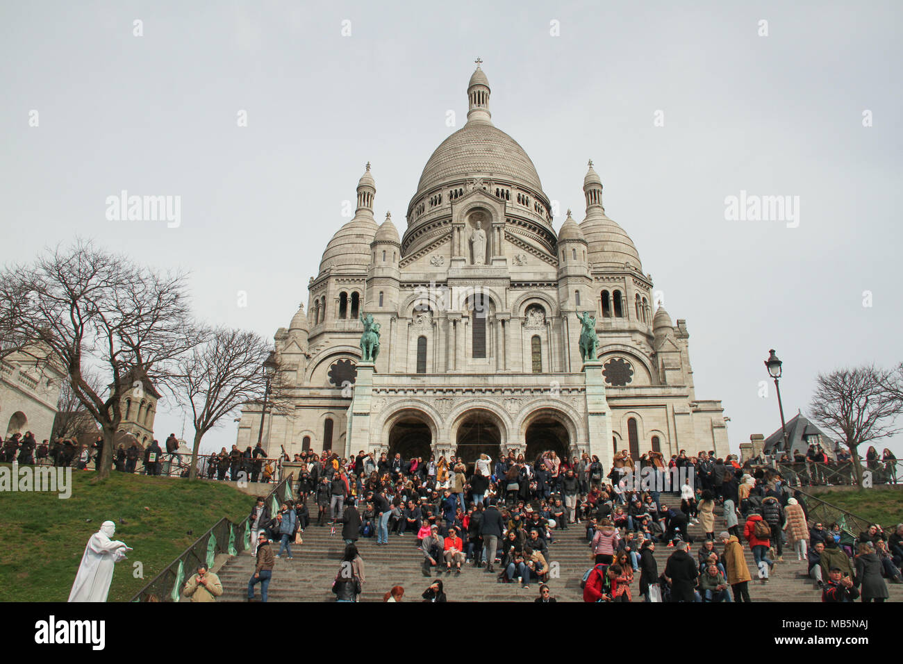 Paris, France -  02 April, 2018. Tourists seen by the Sacre Coeur Cathedral in north Paris on 02 April 2018 over the Ester weekend. General view of Paris, France. @ David Mbiyu/Alamy Live News - Stock Image