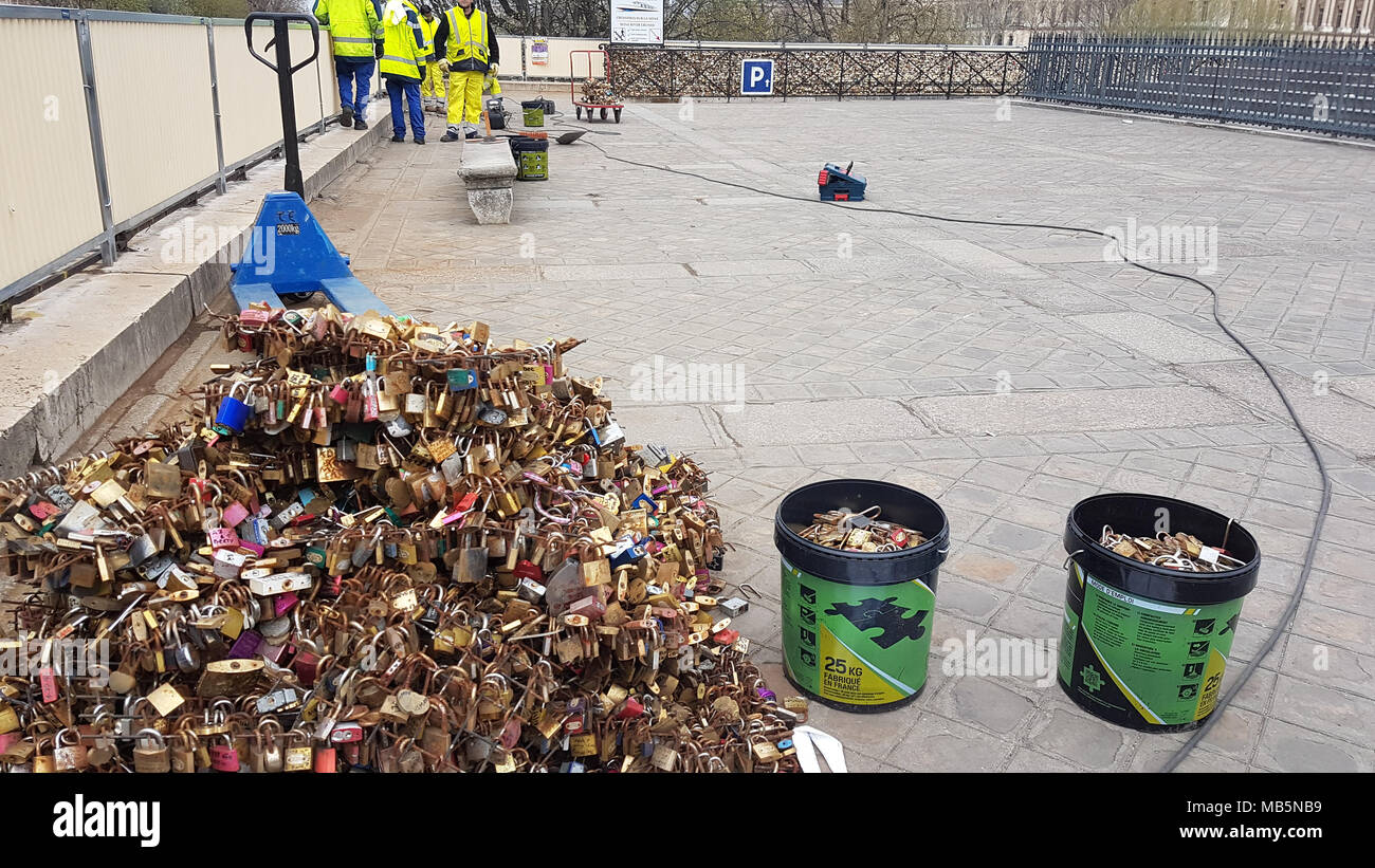 Paris, France -  03 April 2018. Workmen remove Padlocks on the bridge at Pont Neuf on 03 April 2018.  The first Iron bridge built in France, had its railings replaced with glass panels after they collapsed under the weight on the metal padlocks and this culture has cropped up in other bridges in Paris. General view of Paris, France. @ David Mbiyu/Alamy Live News - Stock Image