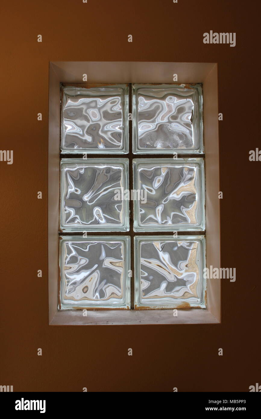 Vintage two by six glass block infill window kit from outside. Stock Photo