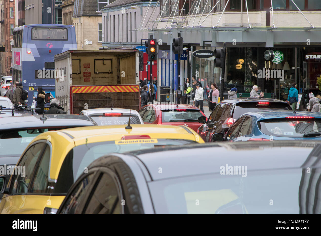 Busy traffic in Glasgow, Scotland, depicting congestion and pollution - Stock Image