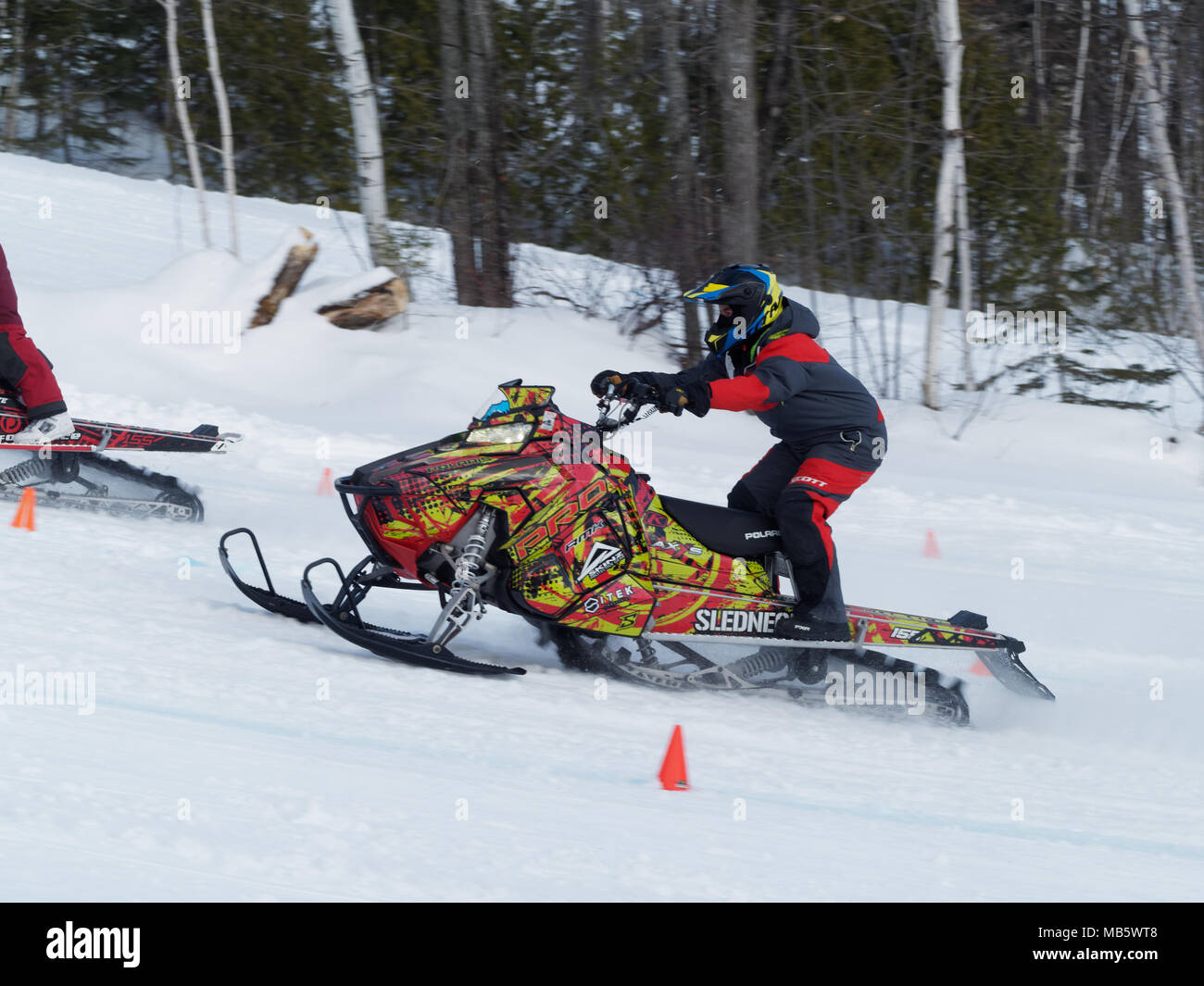 Quebec, Canada 4/7/2018 Snowmobile uphill drag race held on the slopes of Val Saint-Come ski resort - Stock Image