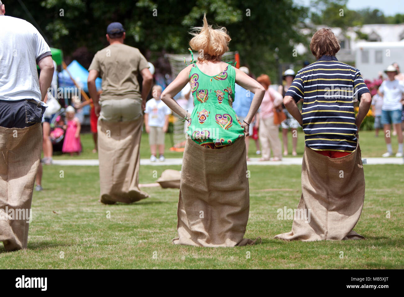 Several unidentified people compete in a sack race at the GREAT festival celebrating Great Britain and the UK, on May 25, 2013 in Atlanta, GA. - Stock Image