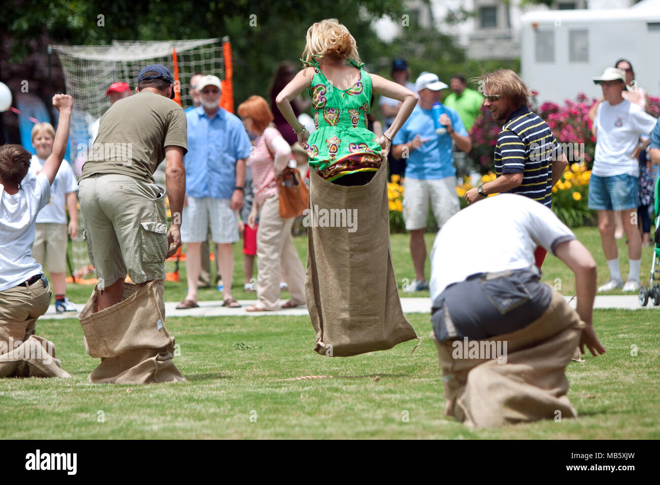 Several people compete in a sack race at the GREAT festival, a spring festival celebrating Great Britain and the UK on May 25, 2012 in Atlanta, GA. Stock Photo