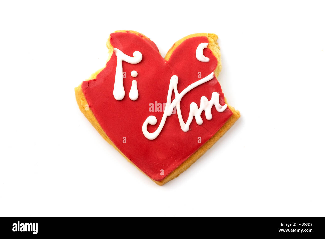Bitten 'Ti amo' (i love you) cookie on a white background - Stock Image