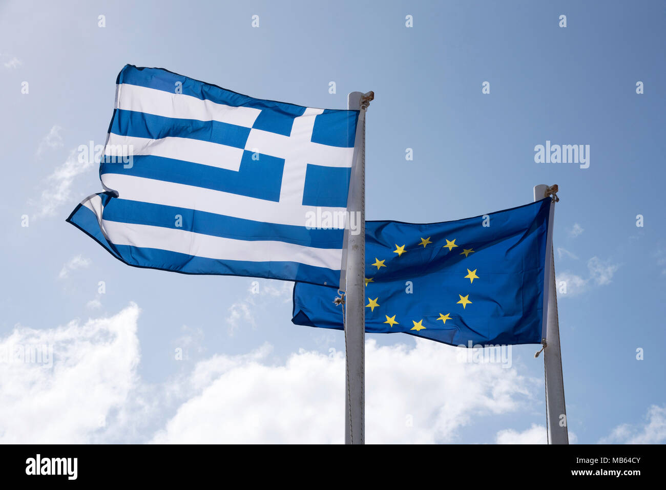 The Greek flag and the European Union flags flying together Stock Photo