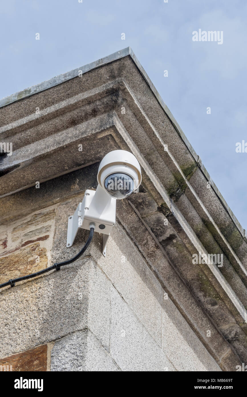 CCTV security camera on corner of building - Watching over You, surveillance / Orwellian / Big Brother / intelligence gathering, crime prevention. Stock Photo