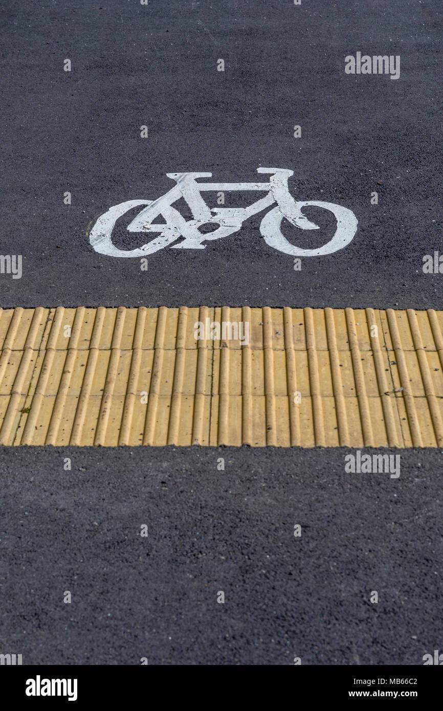 Bike lane / Cycle way marking in Bodmin, Cornwall. - Stock Image