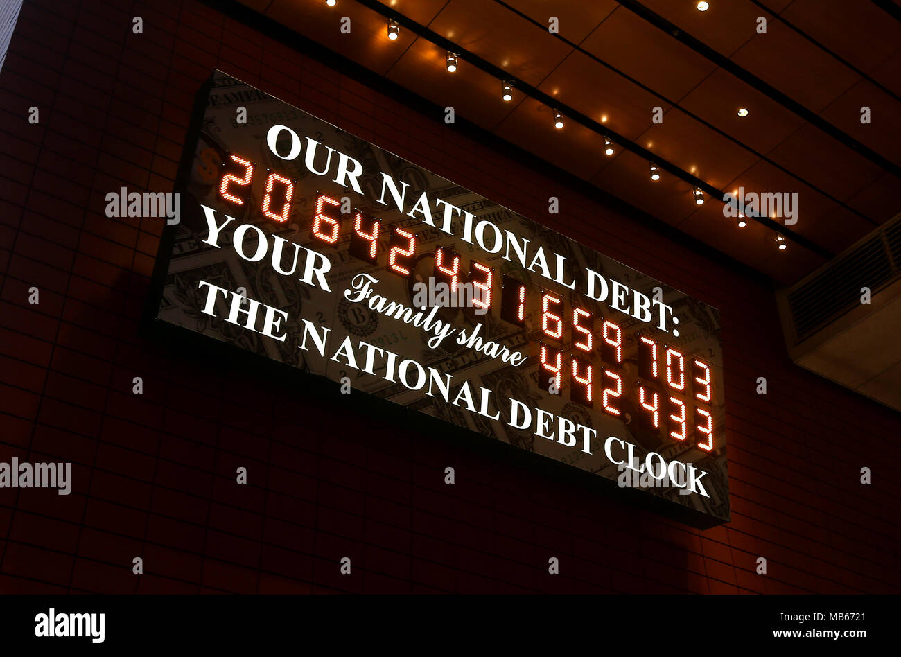 The National Debt Clock just off from Times Square, New York City, USA. The clock shows the ammount of debt owned by USA pictured on March 31 2018. - Stock Image