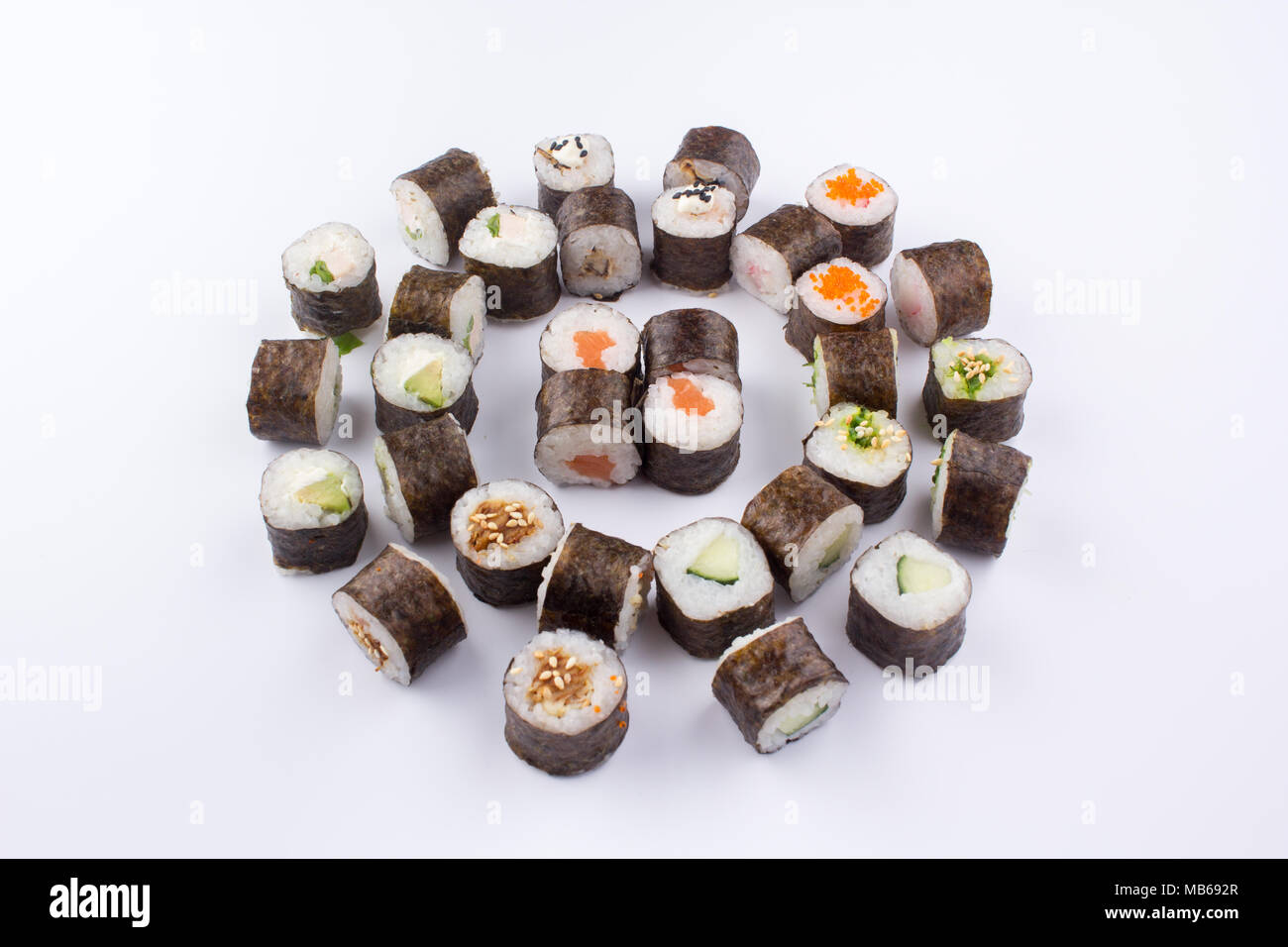A set of sushi rolls laid out in an original way. - Stock Image