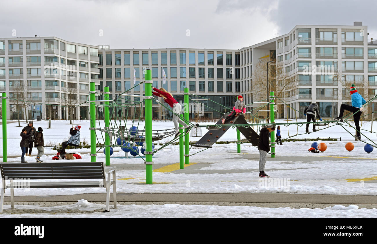 Children play in playground in Hesperia park. Early spring Stock Photo