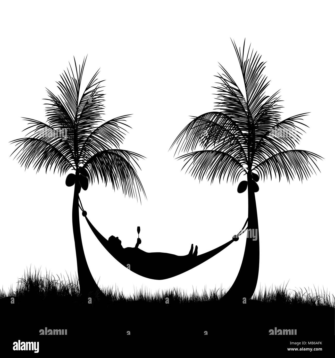 relaxing in a hammock at the beach after a hard days work - Stock Image