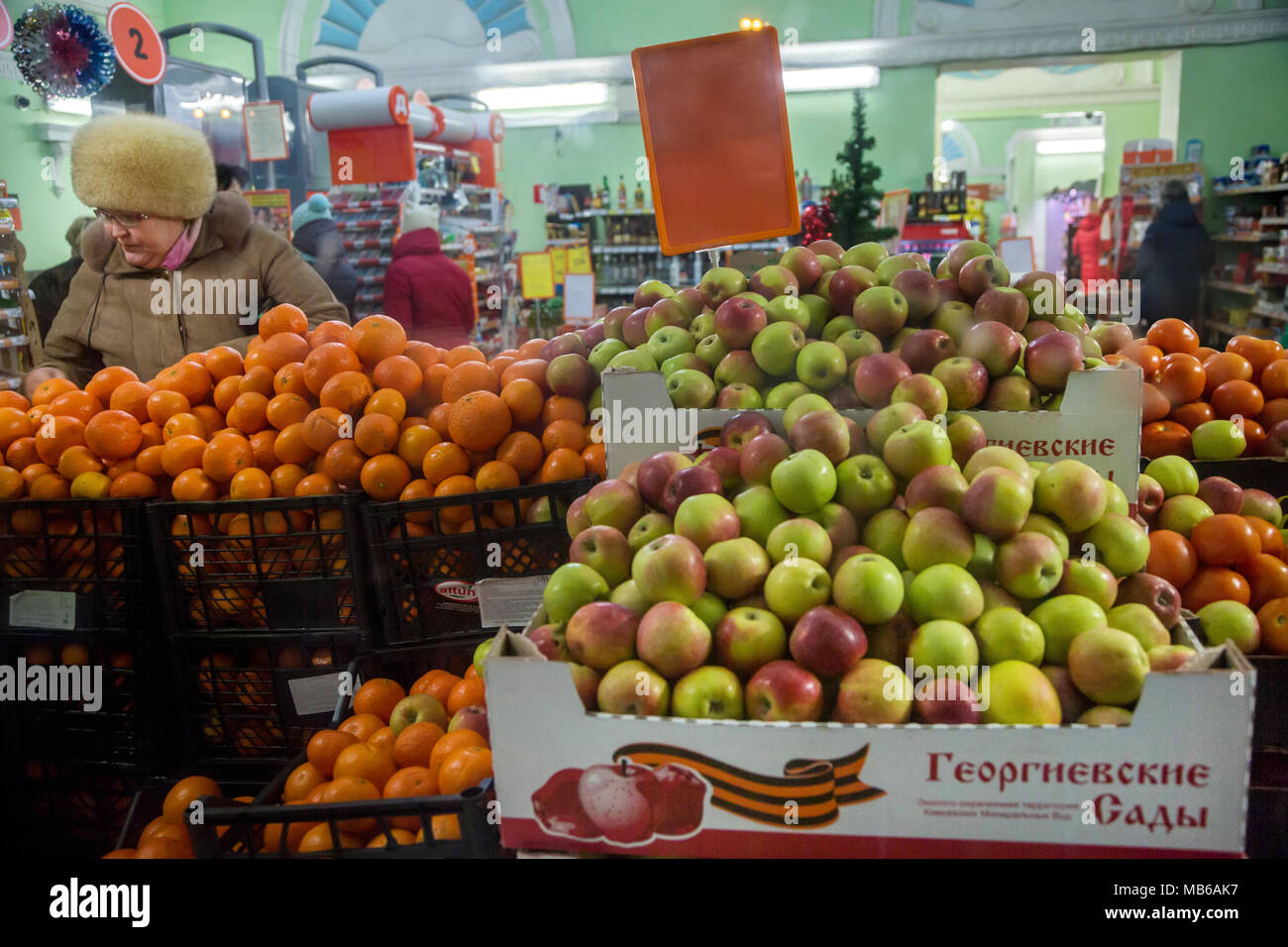 A woman chooses fruits in the grocery store of Kolomna town, Moscow region, Russia - Stock Image