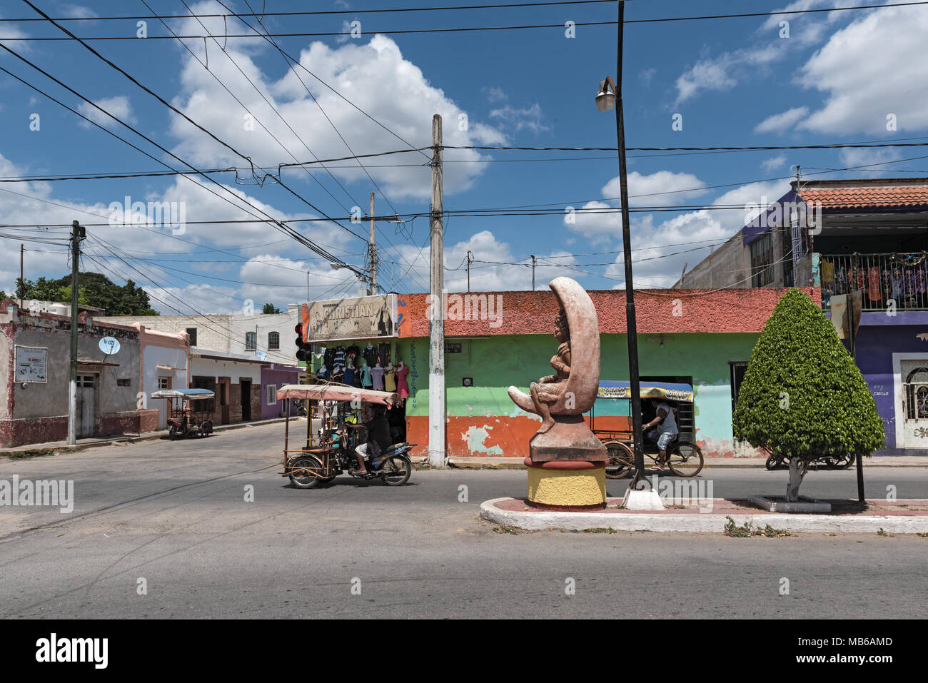 Road junction with two tricycles in Ticul, yucatan, Mexico - Stock Image