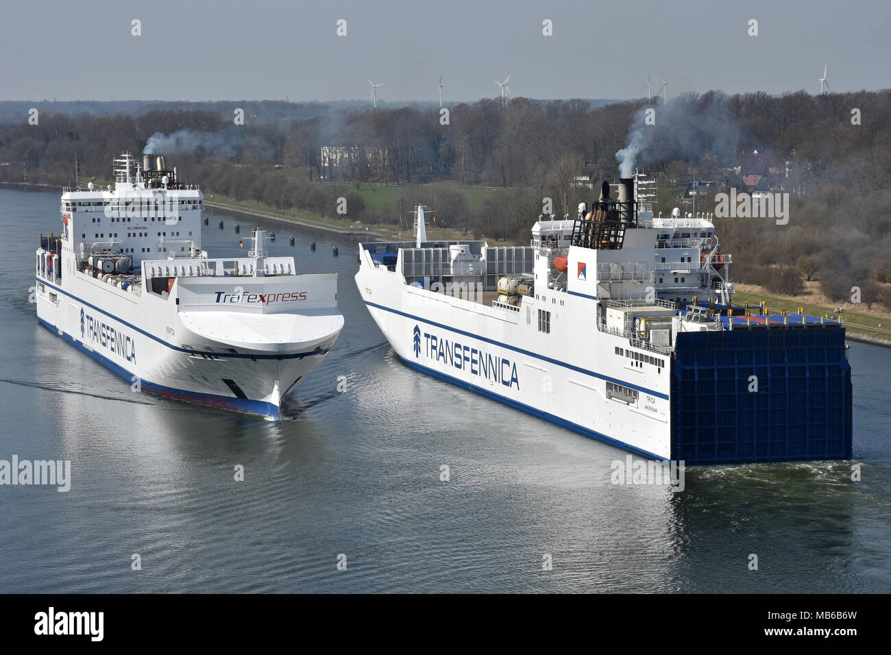 Transfennica sistervessels Kraftca & Trica meeting in the Kiel Canal - Stock Image