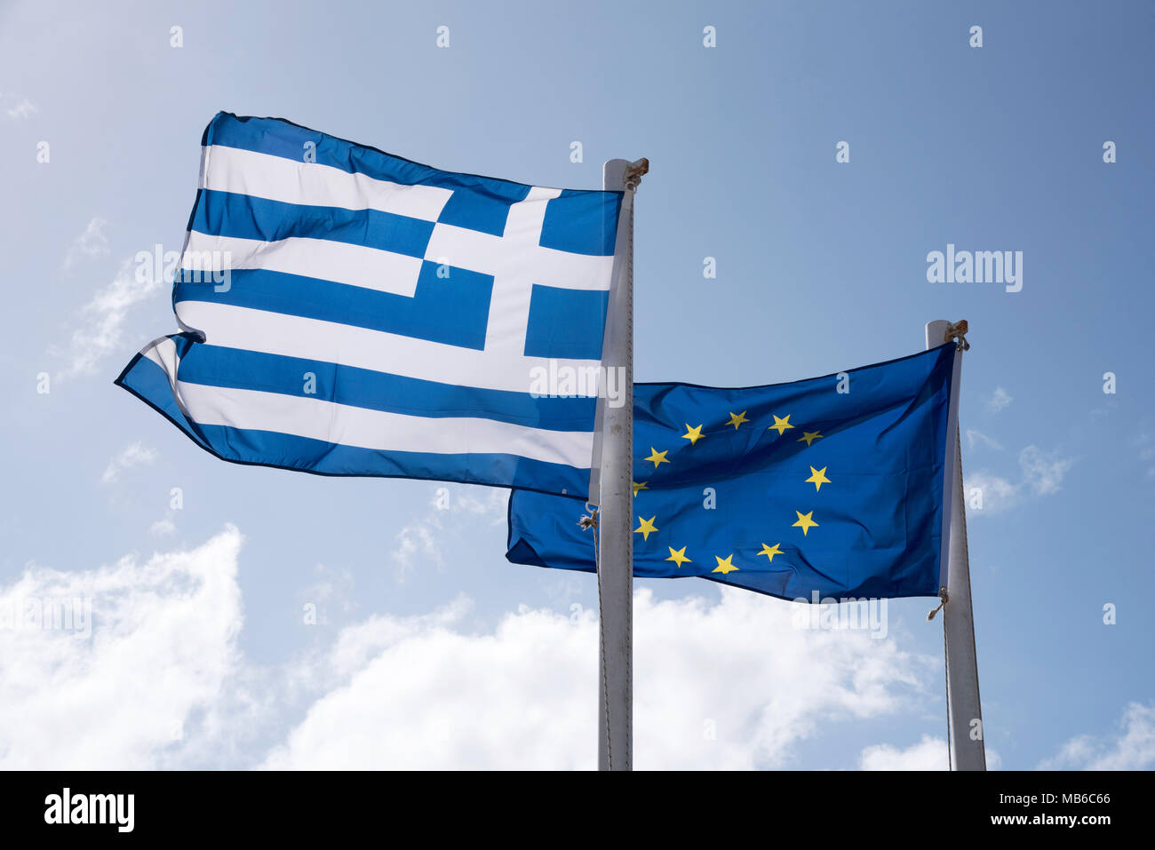 The Greek flag and the European Union flags flying together - Stock Image