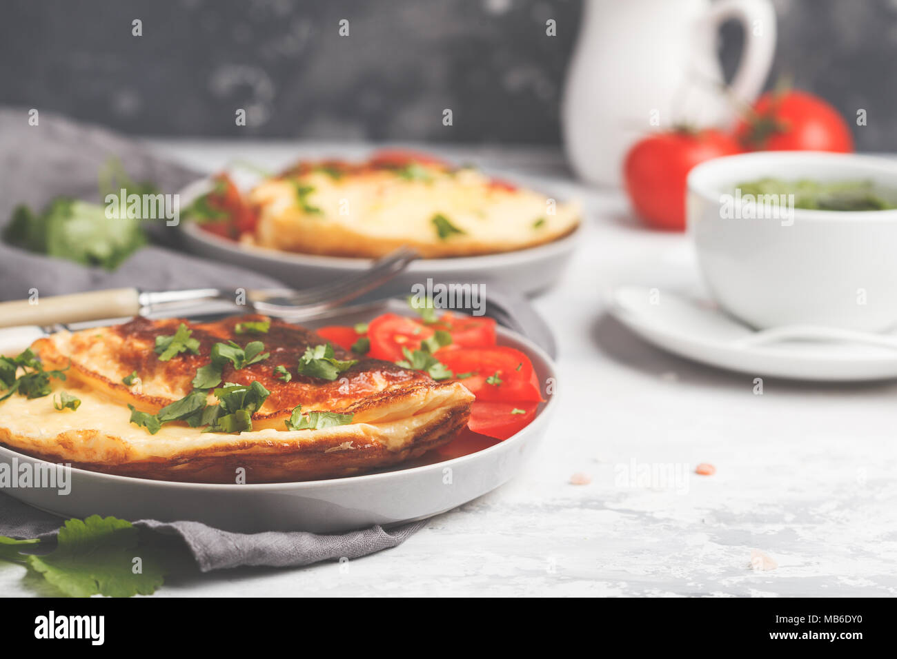 Delicious bright egg omelet with cheese and vegetables. Breakfast food concept. - Stock Image