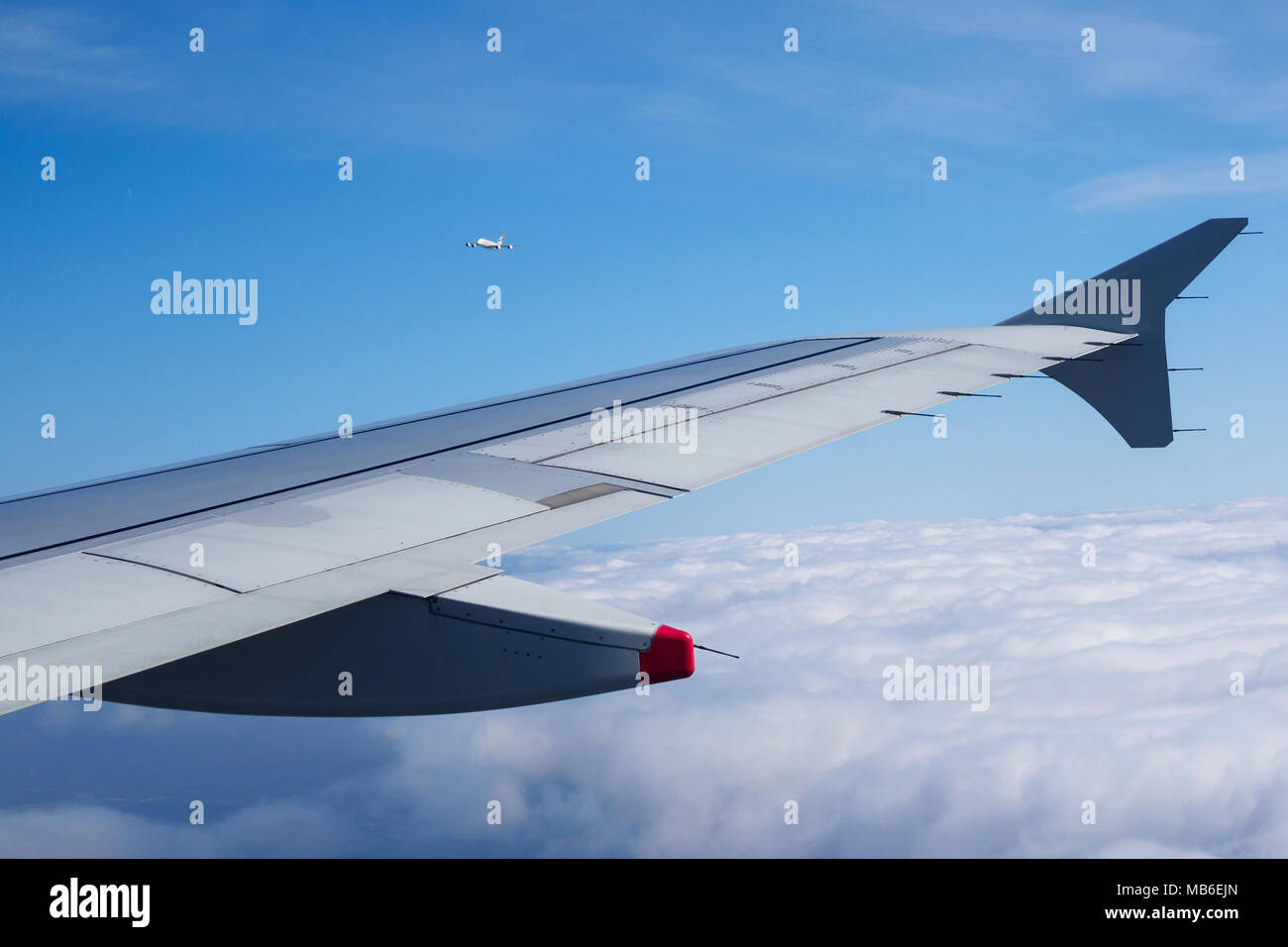 View from a British Airways Airbus A320 shortly after takeoff from Heathrow Airport showing a close encounter with another aircraft - Stock Image