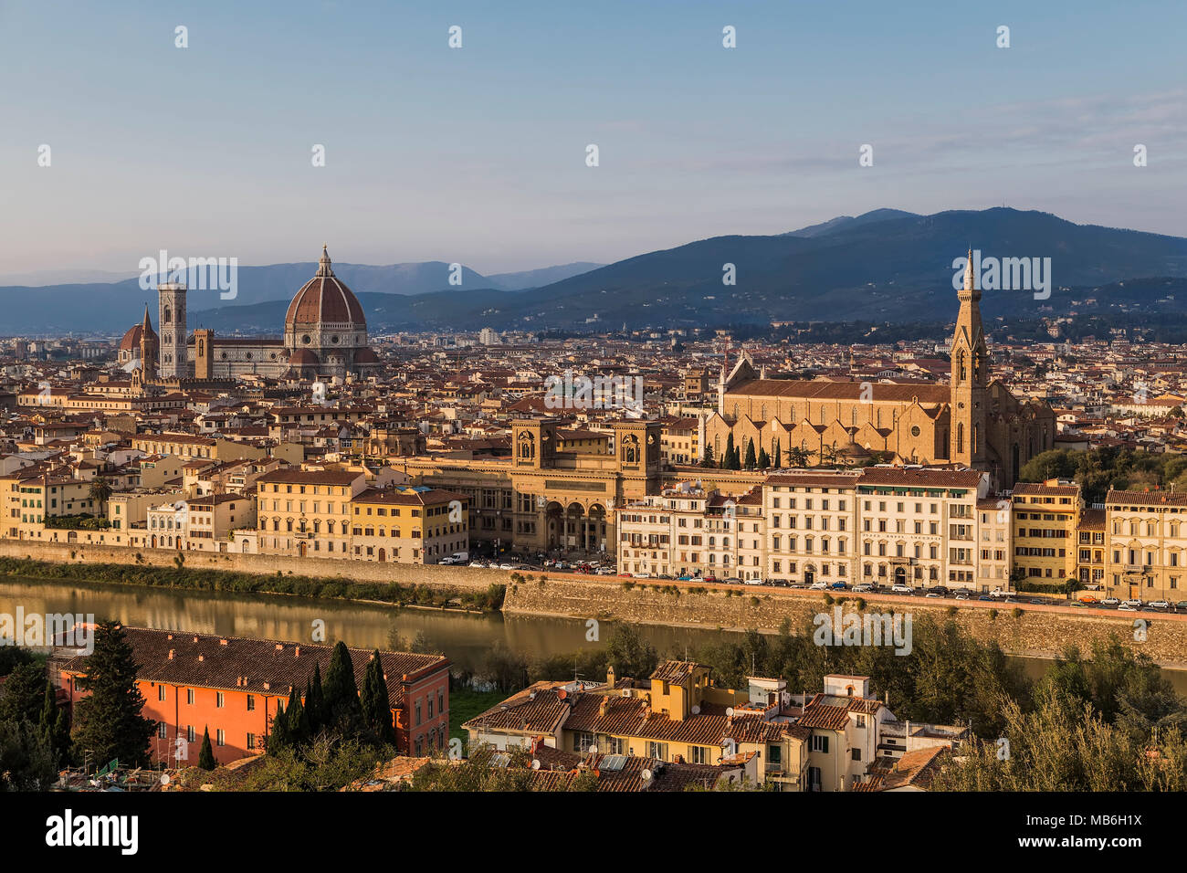 View of the Arno River, the Basilica of Santa - Croce and Santa - Maria - Del - Fiore in Florence. Italy. - Stock Image