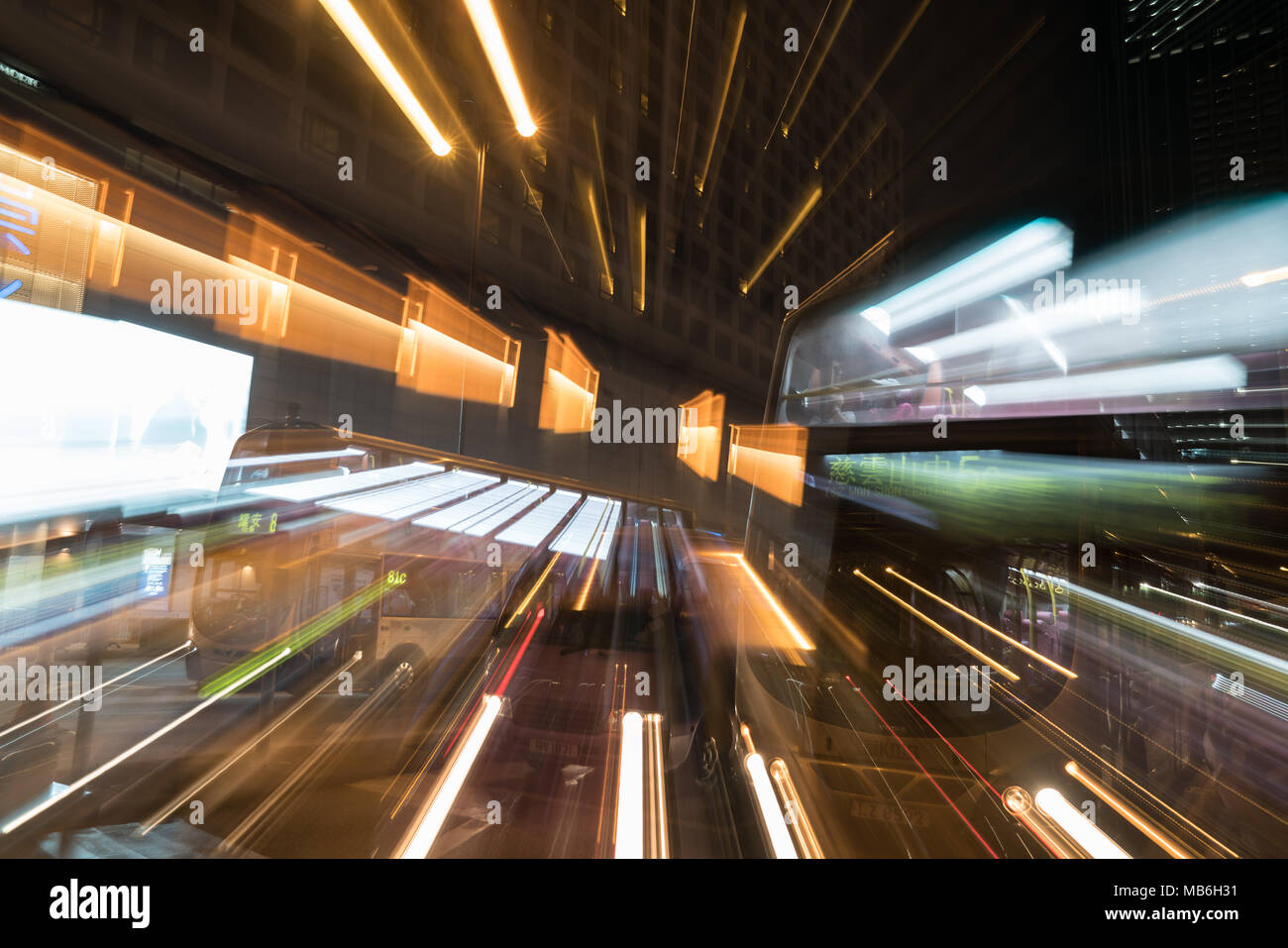KOWLOON HONG KONG, SEPTEMBER 20, 2017;Night long exposure of passing vehicles on busy city street. - Stock Image