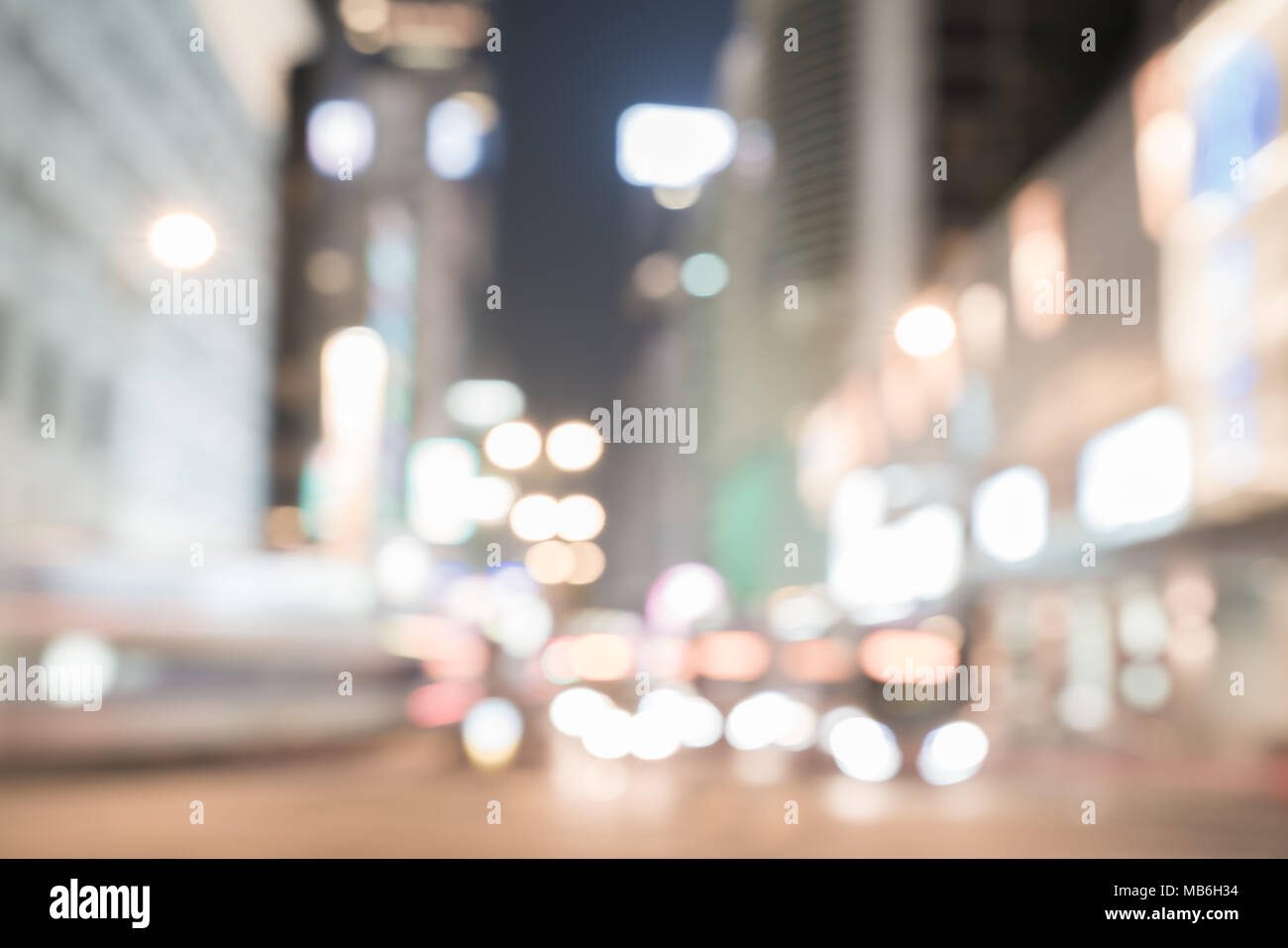 KOWLOON HONG KONG, SEPTEMBER 20, 2017;Night long exposure of passing vehicles on busy city street. Stock Photo