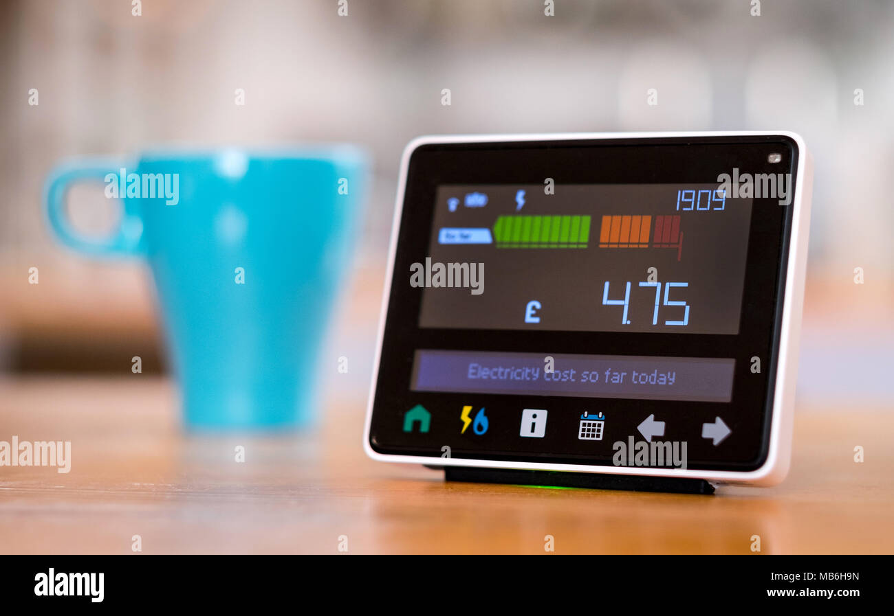 Energy monitor ( Smart Metre ) in the kitchen of a UK home - Stock Image