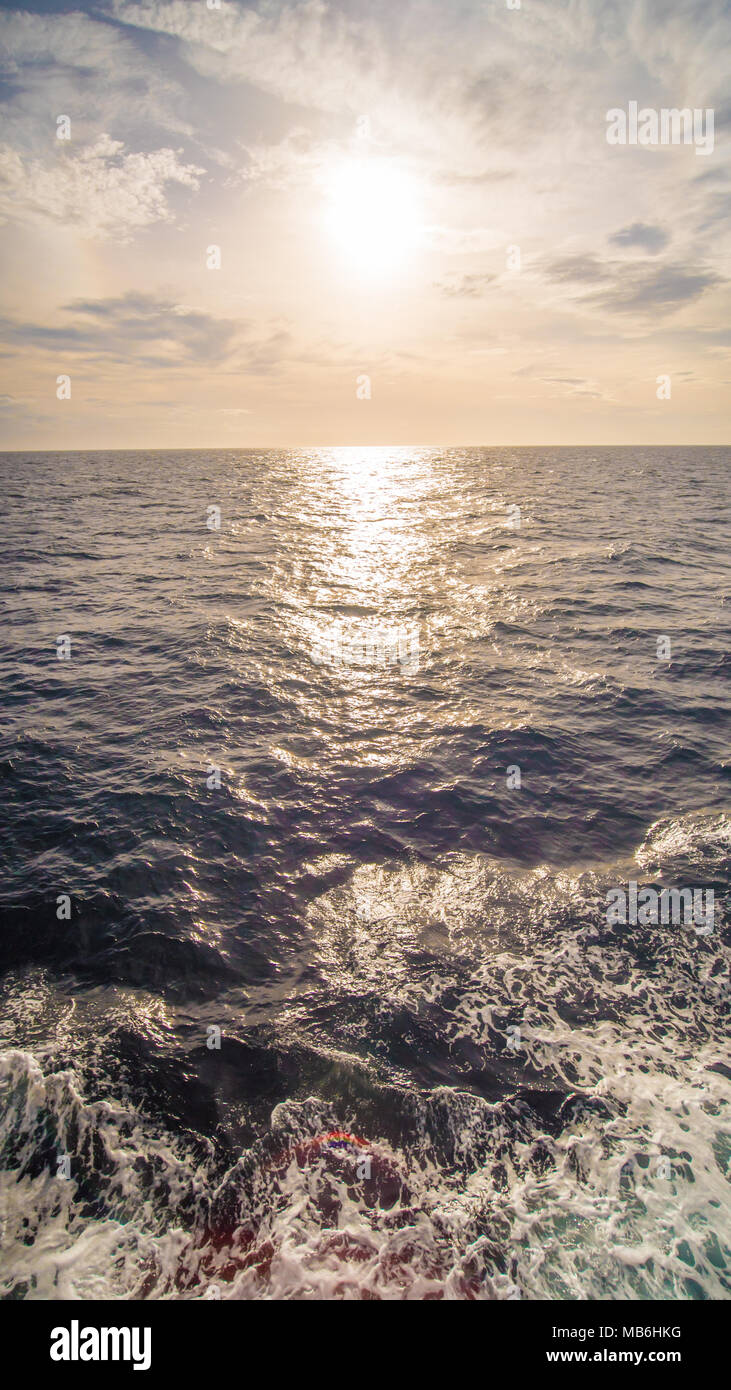 Beautiful huge ocean on a background of the setting sun. - Stock Image