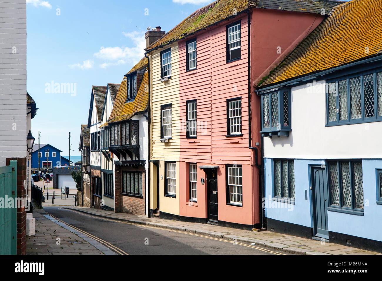 HASTINGS, UK - APRIL 5th, 2018: View of street in seaside town of Hastings with traditional house.  Hastings is a historic town known for the 1066 Bat - Stock Image