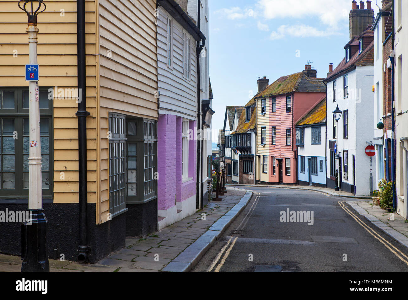 HASTINGS, UK - APRIL 5th, 2018: View of quiet street in seaside town of Hastings with traditional house.  Hastings is a historic town known for the 10 - Stock Image