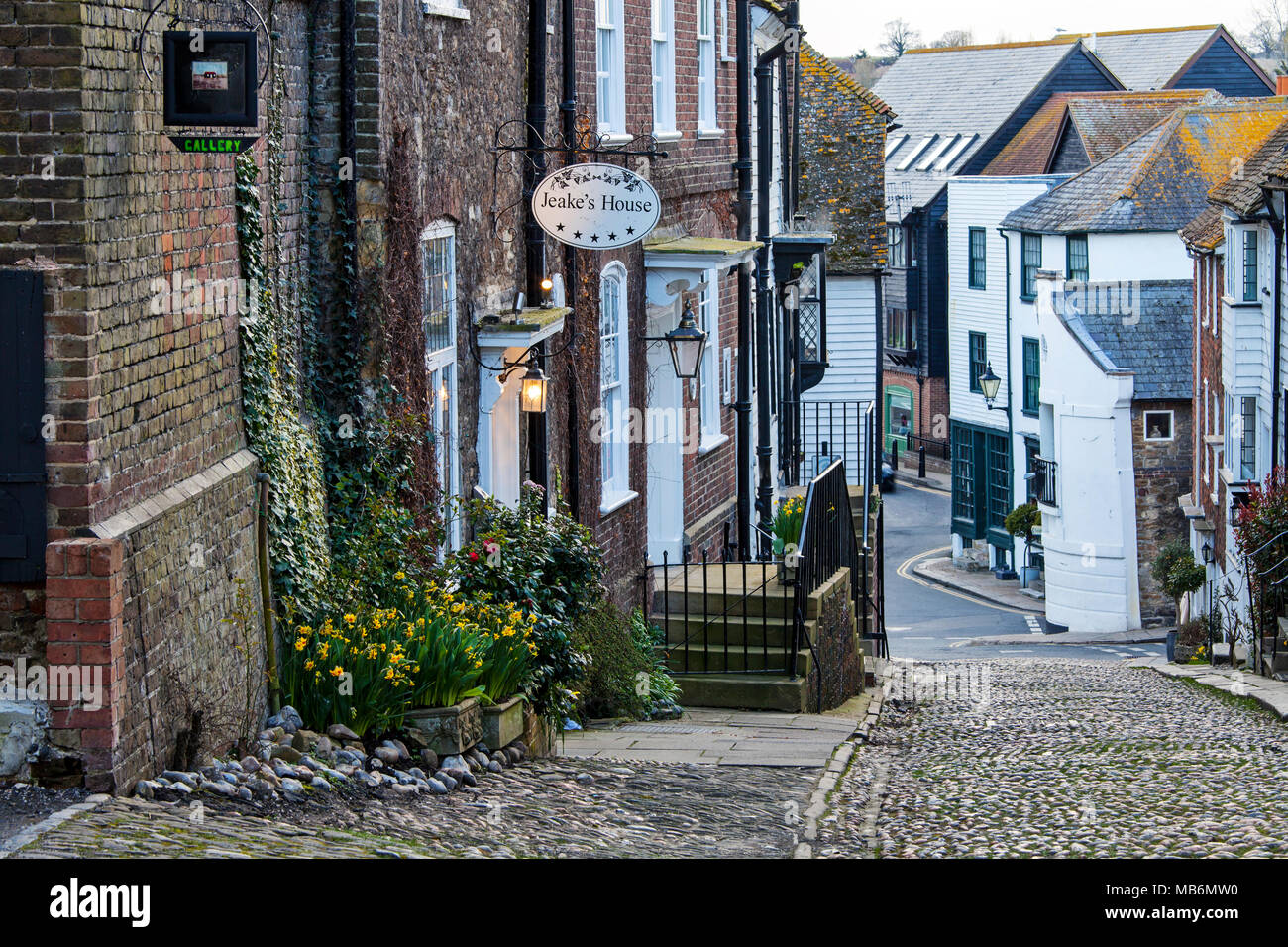 RYE, UK - APRIL 5th, 2018: Mermaid Street in  Rye is an old cobbled street which used to be the ancient town's main road. This famous street is lined  - Stock Image