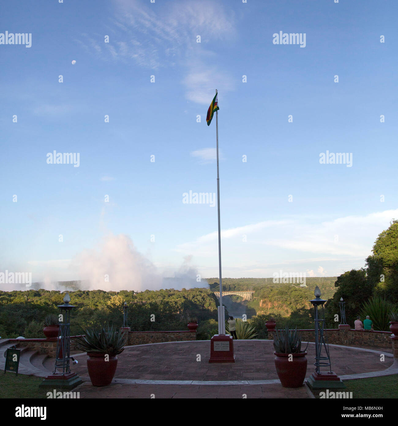 Flagpole in the garden of the Victoria Falls Hotel at Victoria Falls, Zimbabwe. - Stock Image