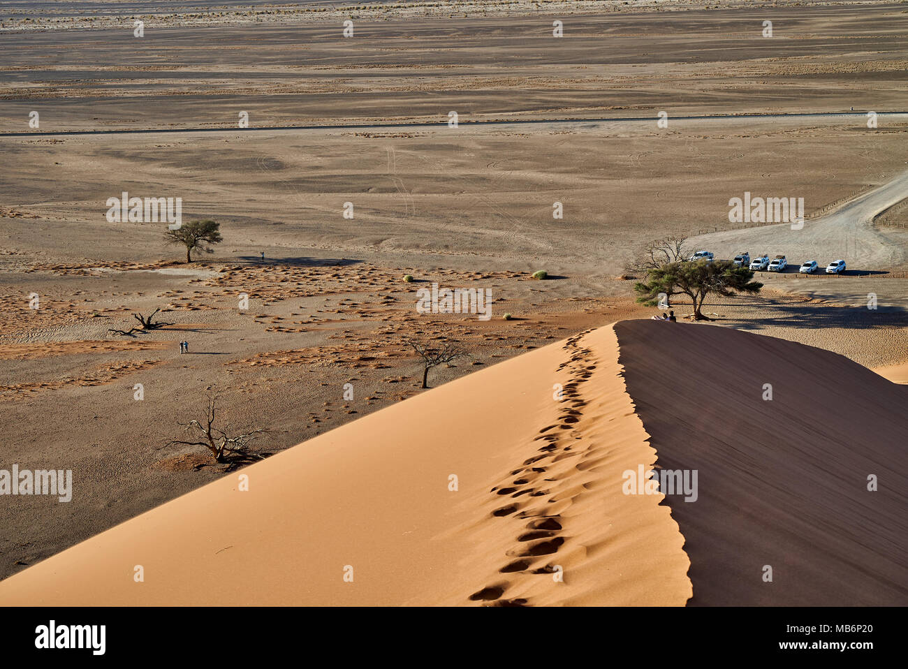 view from dune 45 into valley, desert landscape of Namib - Stock Image