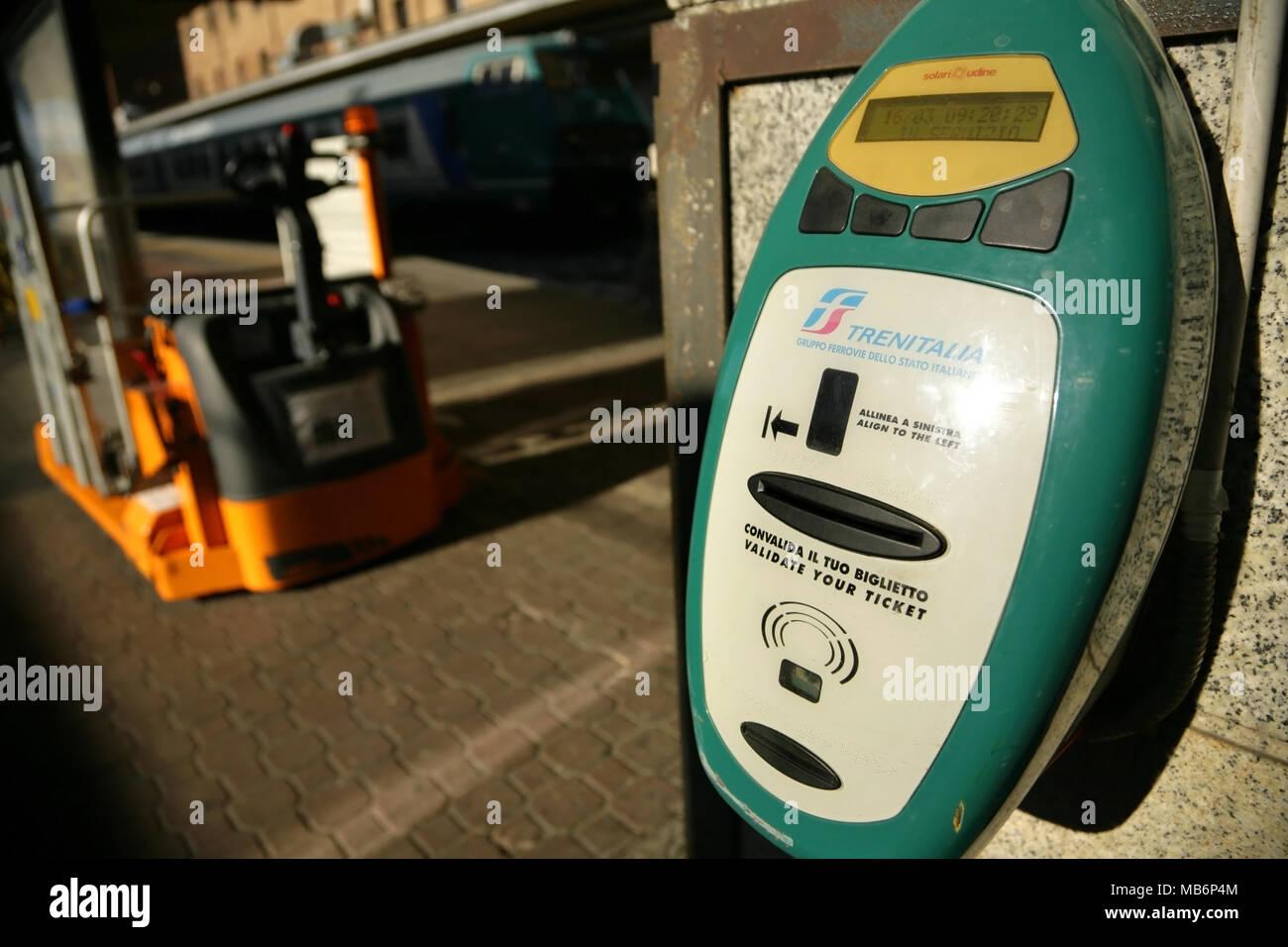Italian railways ticket validation machine. - Stock Image