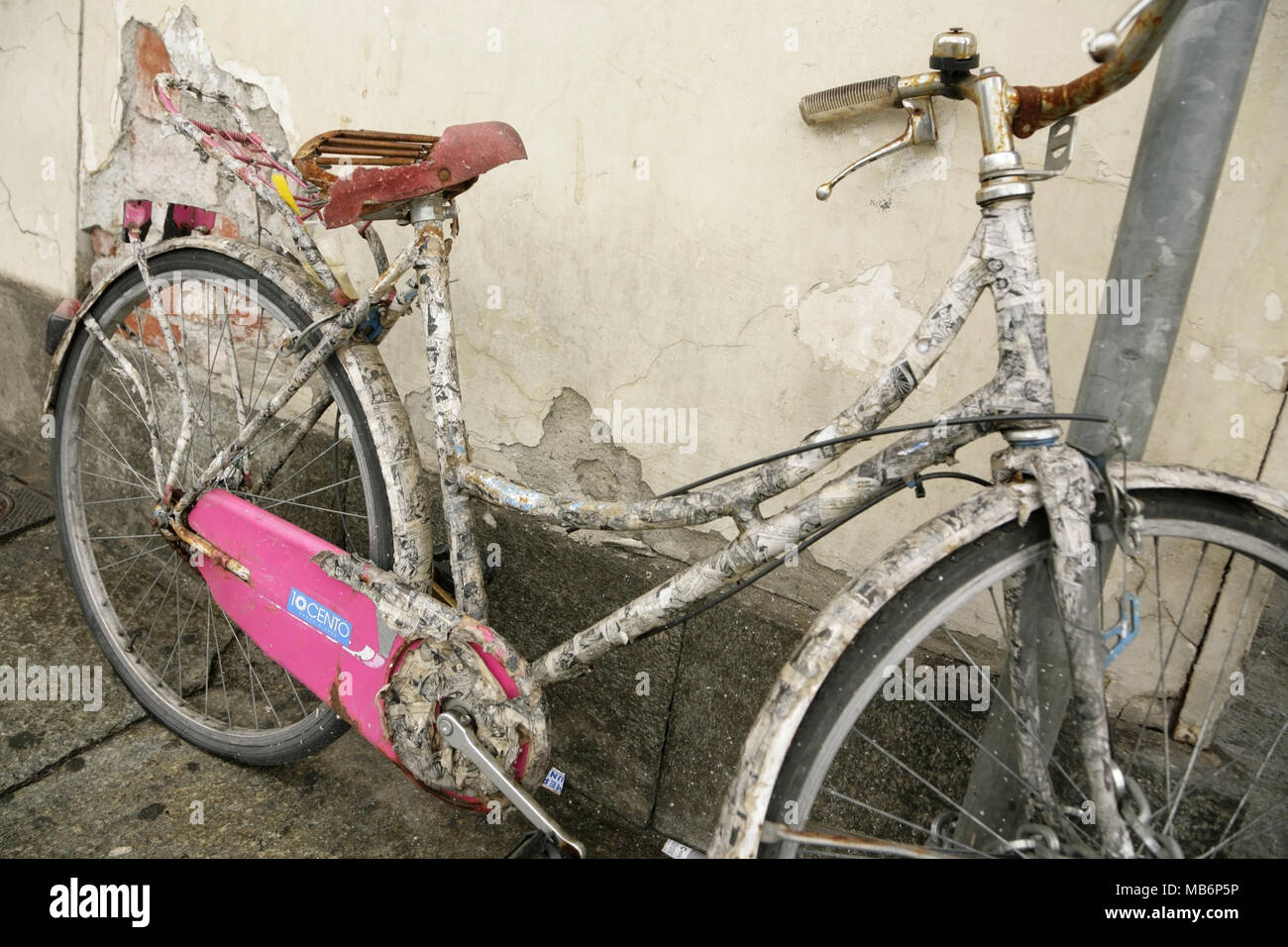 Old bicycle covered in papier mache. - Stock Image