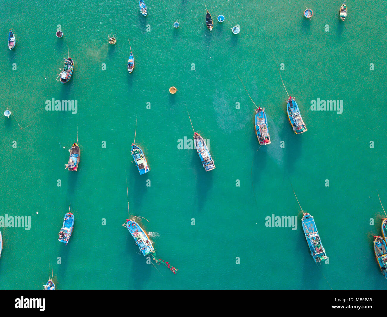 Top view. Aerial view fishing harbour from drone. Royalty high quality free stock image of basket boat at Mui Ne fishing harbour or fishing village - Stock Image