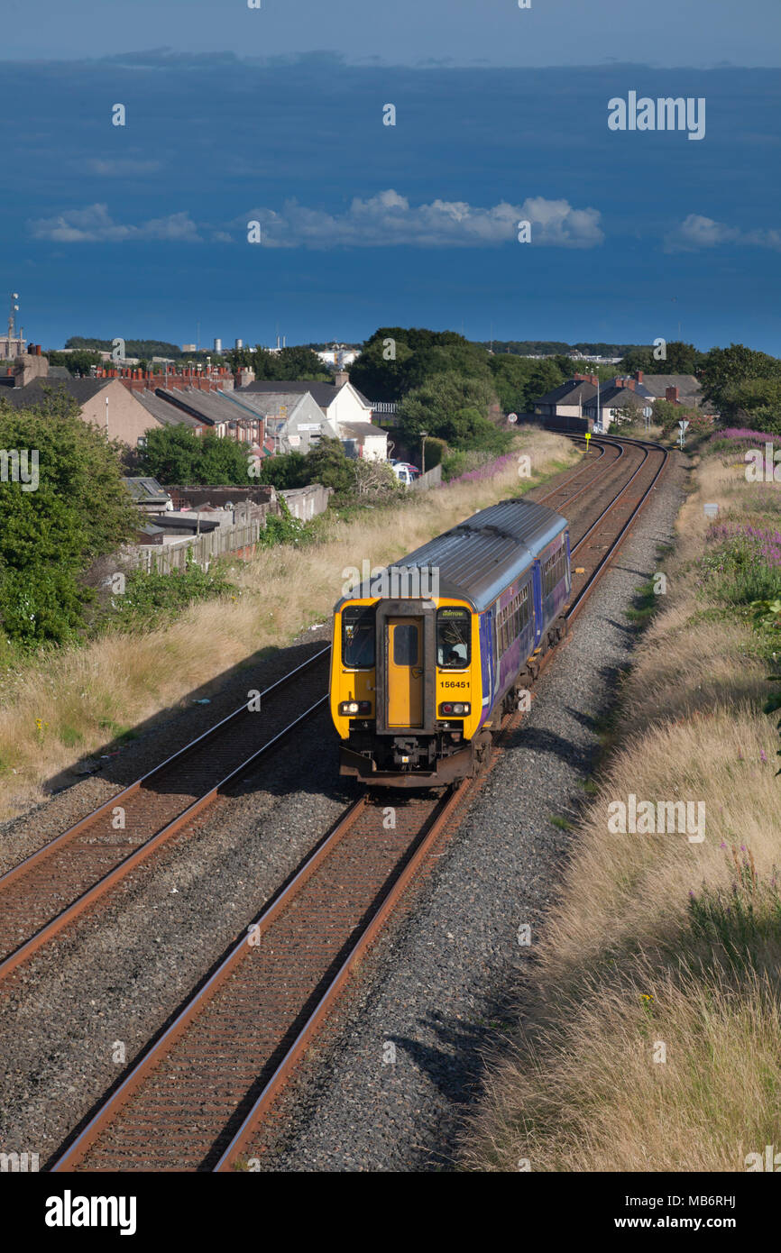 A Northern Rail class 156 sprinter train approaching  Barrow in Furness - Stock Image