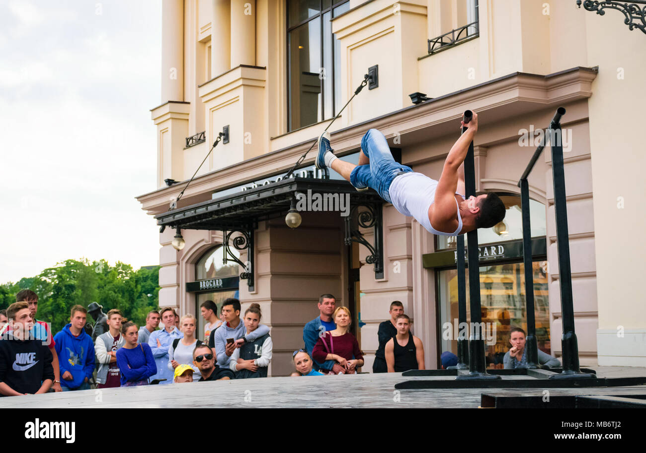 Uzhgorod, Ukraine - Jun 10, 2016: participants of outdoor sports competition. workout championship in Uzhgorod. Young men show their skill on the aren - Stock Image
