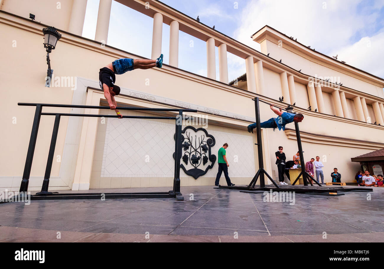 Uzhgorod, Ukraine - Jun 10, 2016: participants of outdoor sports competition. workout championship in Uzhgorod. Young men show their skill on the aren Stock Photo