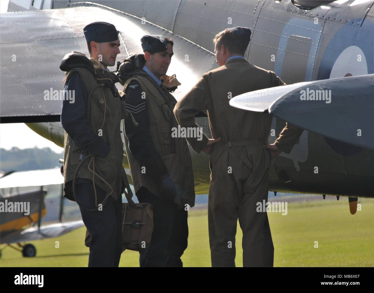 Airmen standing beside a Bristol Blenheim bomber, modern with period costume 're enactors. - Stock Image