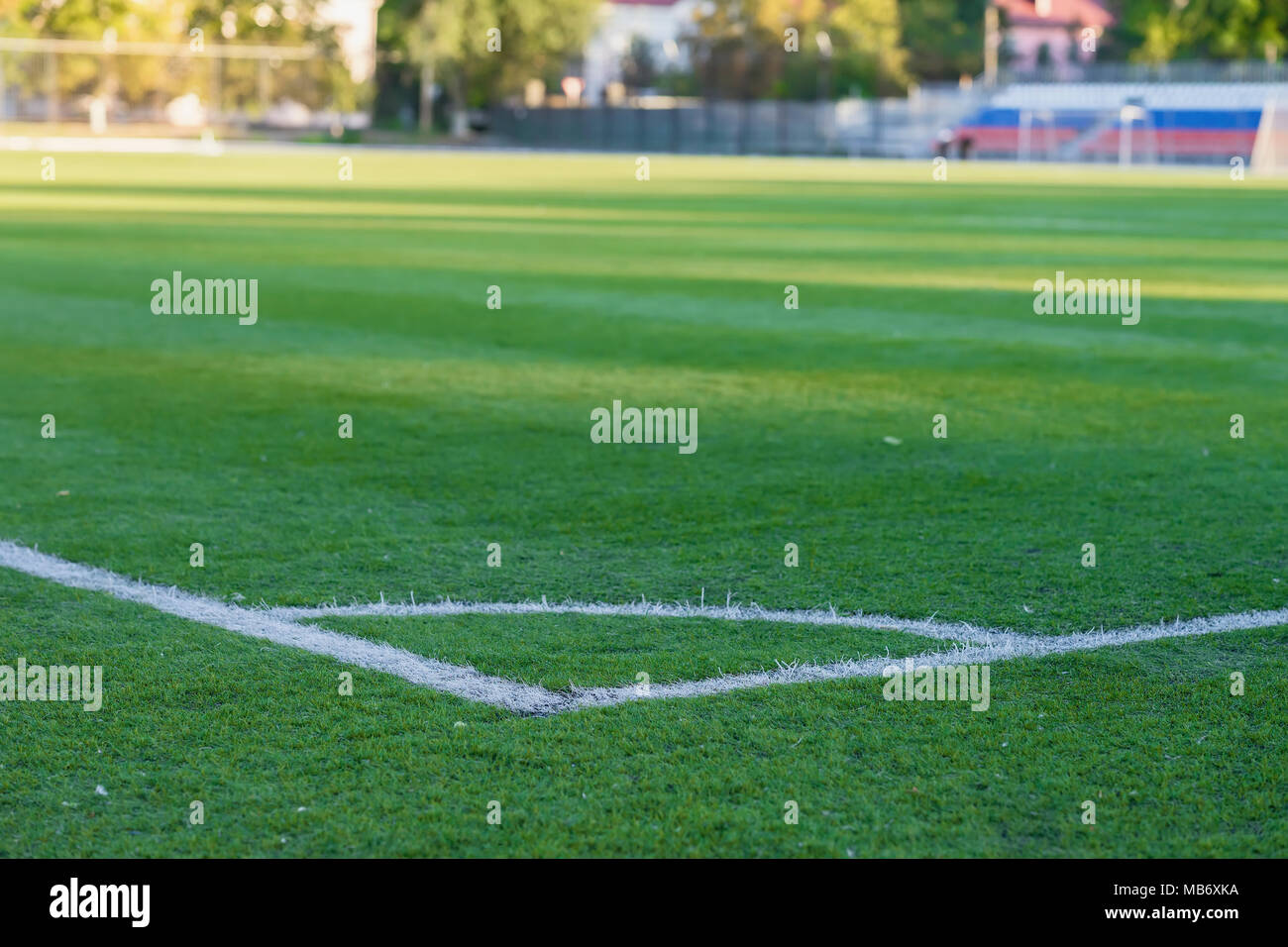 green grass football field grass texture seamless corner of soccer field pattern green grass for football sport stadium sport texture selective focus