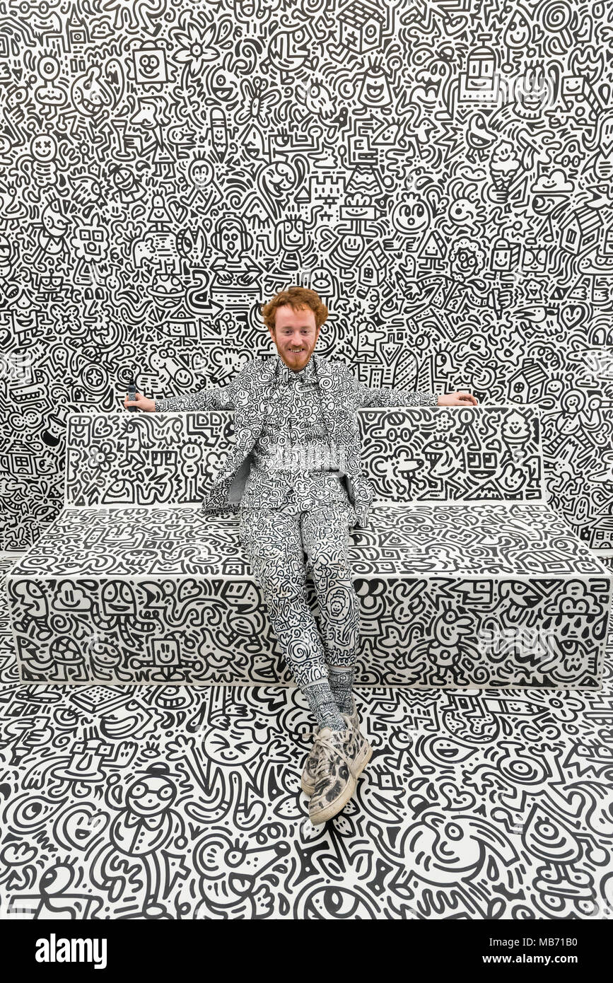 London, UK. 7 April 2018. The artist Mr Doodle poses with his distinctive artwork in The Doodle Room at 'Sense of Space', an art pop-up which has opened to the public in Broadgate.  Comprising four rooms to challenge the visitor's sensory perceptions through art, the installation is open until 18 May. Credit: Stephen Chung / Alamy Live News - Stock Image