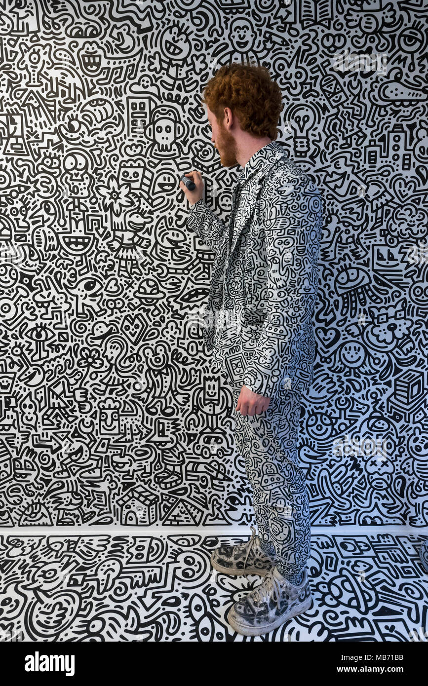 London, UK. 7 April 2018. The artist Mr Doodle creates his distinctive artwork in The Doodle Room at 'Sense of Space', an art pop-up which has opened to the public in Broadgate.  Comprising four rooms to challenge the visitor's sensory perceptions through art, the installation is open until 18 May. Credit: Stephen Chung / Alamy Live News - Stock Image