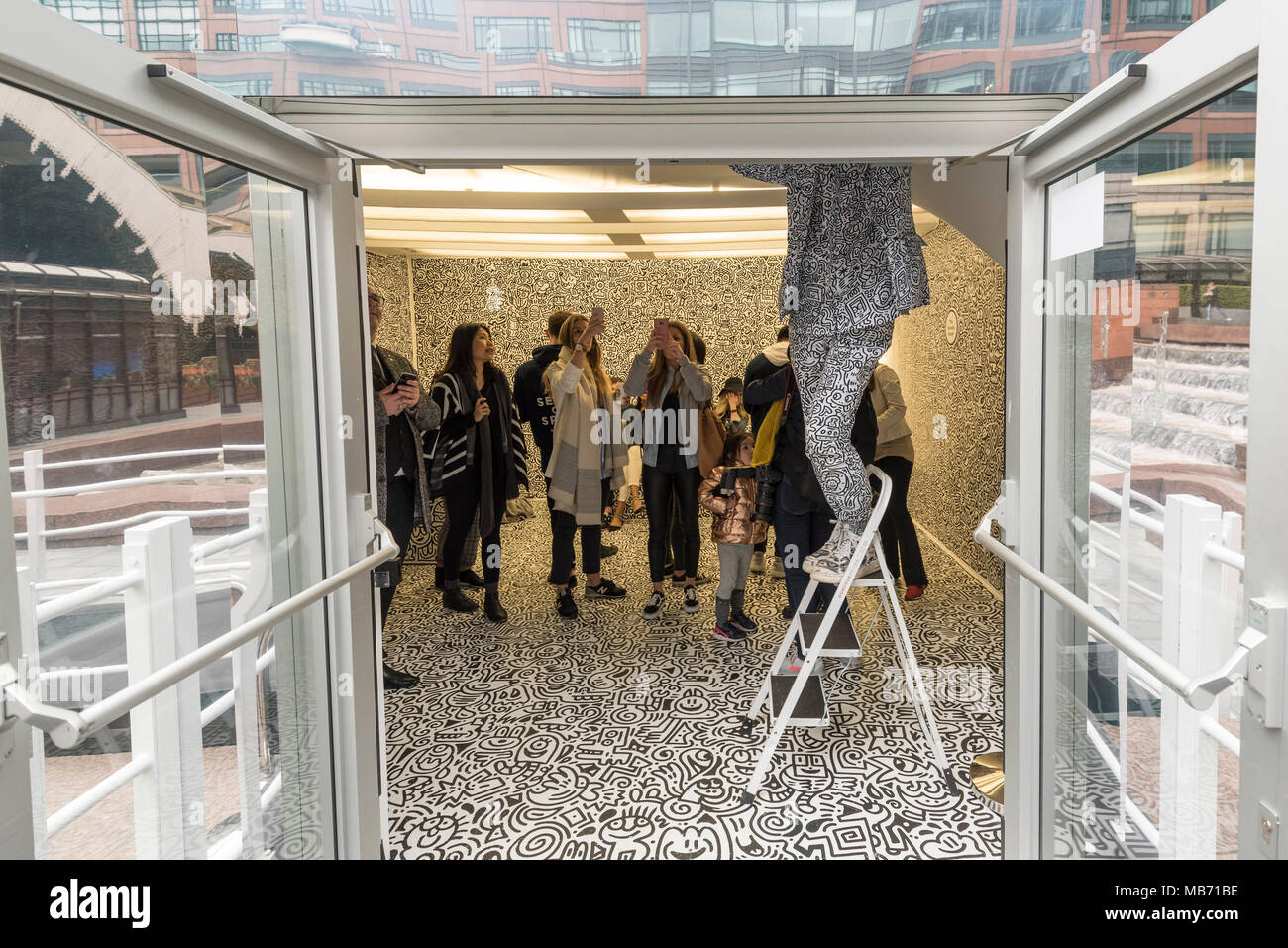 London, UK. 7 April 2018.  The artist Mr Doodle stands on a ladder creating his distinctive artwork in The Doodle Room at 'Sense of Space', an art pop-up which has opened to the public in Broadgate.  Comprising four rooms to challenge the visitor's sensory perceptions through art, the installation is open until 18 May.  Credit: Stephen Chung / Alamy Live News - Stock Image
