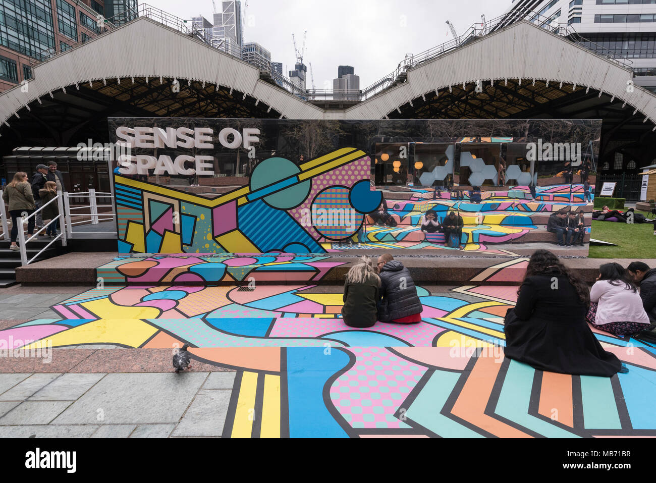 London, UK. 7 April 2018.  The colourful entrance mural by graphic designer artist Supermundane outside 'Sense of Space', an art pop-up which opened to the public in Broadgate.  Comprising four rooms to challenge the visitor's sensory perceptions through art, the installation is open until 18 May.   Credit: Stephen Chung / Alamy Live News - Stock Image