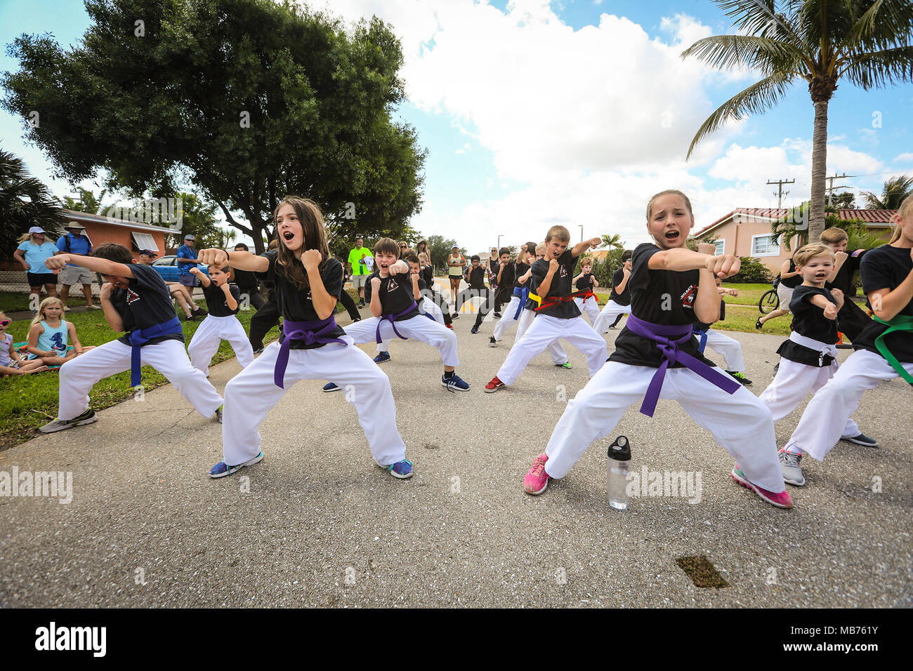 Florida, USA. 7th Apr, 2018. Legacy Mixed Martial Arts participates in the North Palm Beach Heritage Day Parade Saturday, April 7, 2018. The Parade featured bands, civic groups, clubs and organizations from the area. It traveled from North Palm Beach Village Hall north on Eastwind Drive, west on Lighthouse Drive, and south on Anchorage Drive, to end at Anchorage Park. The Heritage Festival held at Anchorage Park featured a business expo, carnival rides, food and drinks.games, musical entertainment, a cornhole tournament, and more. (Credit Image: © Bruce R. Bennett/The Palm Beach Post via Z - Stock Image