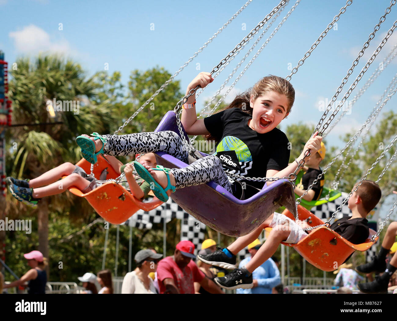 Florida, USA. 7th Apr, 2018. Children enjoy the Swinger ride at the North Palm Beach Heritage Day Festival in Anchorage Park Saturday, April 7, 2018. Following a Parade featuring bands, civic groups, clubs and organizations from the area, the Festival at Anchorage Park featured a business expo, carnival rides, food and drinks.games, musical entertainment, a cornhole tournament, and more. Credit: Bruce R. Bennett/The Palm Beach Post/ZUMA Wire/Alamy Live News - Stock Image