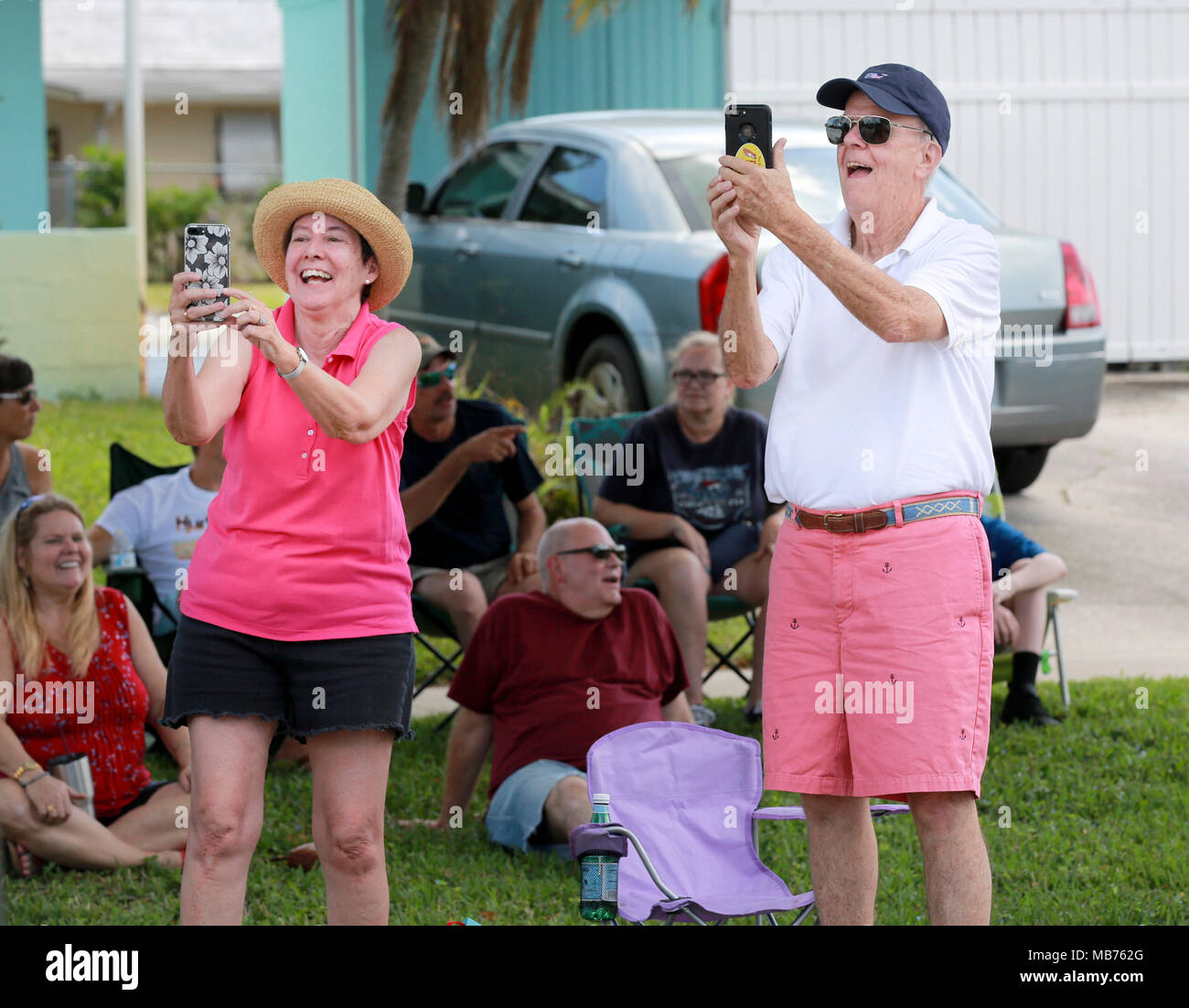 Florida, USA. 7th Apr, 2018. Onlookers watch as the North Palm Beach Heritage Day parade passes by on Saturday, April 7, 2018. The Parade featured bands, civic groups, clubs and organizations from the area. It traveled from North Palm Beach Village Hall north on Eastwind Drive, west on Lighthouse Drive, and south on Anchorage Drive, to end at Anchorage Park. The Heritage Festival at Anchorage Park featured a business expo, carnival rides, food and drinks, games, musical entertainment, a cornhole tournament, and more. Credit: Bruce R. Bennett/The Palm Beach Post/ZUMA Wire/Alamy Live News - Stock Image