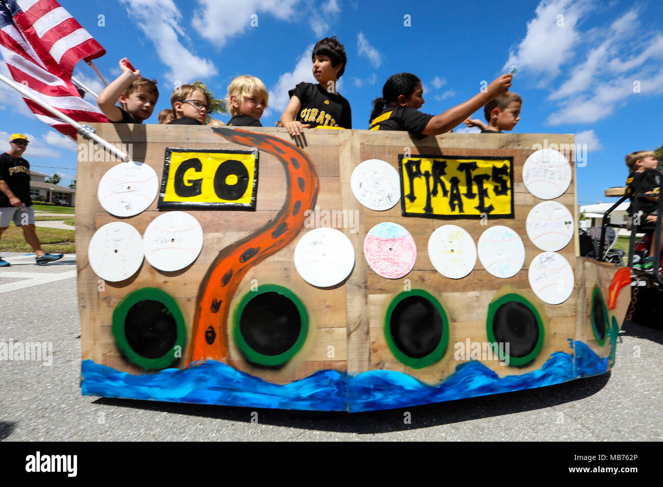 Florida, USA. 7th Apr, 2018. The Pirates Little League baseball team's float travels north on Eastwind Drive during North Palm Beach Heritage Day parade Saturday, April 7, 2018. The Parade featured bands, civic groups, clubs and organizations from the area. It traveled from North Palm Beach Village Hall north on Eastwind Drive, west on Lighthouse Drive, and south on Anchorage Drive, to end at Anchorage Park. The Heritage Festival held at Anchorage Park featured a business expo, carnival rides, food and drinks.games, musical entertainment, a cornhole tournament, and more. (Credit Image: © B - Stock Image